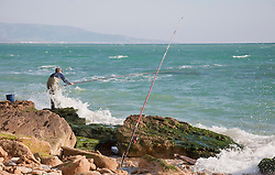View of fisherman at beach near atlantic ocean
