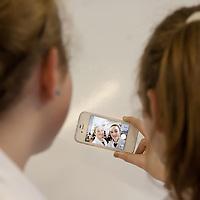 Síofra Ní Chonaill and Oileán Ní Laighin from Gaelcholaíste an Chlaír studying the effect of selfies on people.