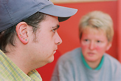 Client listening to discussions during meeting about advice on Tenancy Sustainment,