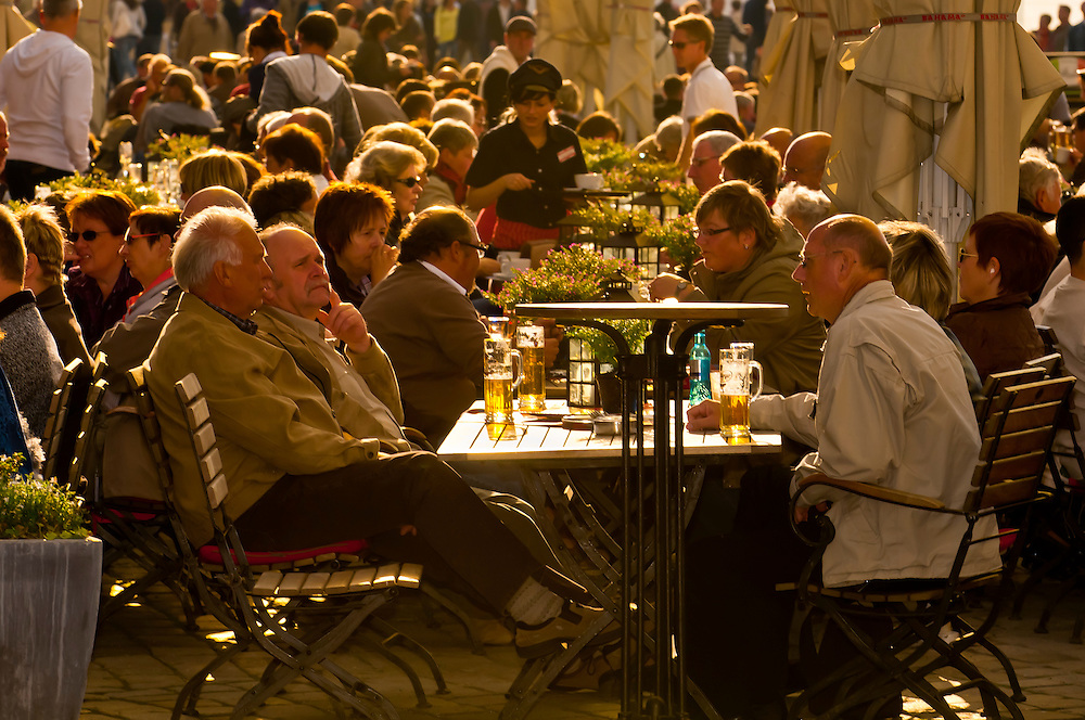 People at sidewalk cafes in the Neumarkt area, Dresden, Saxony, Germany