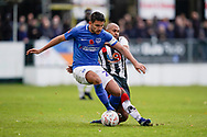 Gareth Evans of Portsmouth is tackled by James Comley of Maidenhead United during the The FA Cup 1st round match between Maidenhead United and Portsmouth at York Road, Maidenhead, United Kingdom on 10 November 2018.