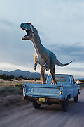 Dave Thomas drives his 33-foot-long (10M) allosaurus to California past the Zia Pueblo Reservation in Arizona.