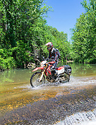 Emily Mathews rides her Honda CRF250L over a low water crossing near the Buffalo River.