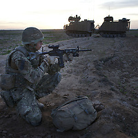 British soldiers of 16 Air Assault Bde's elite BRF (Brigade Reconnaissance Force) provide a security cordon as other troops move from compound to compound searching for weapons and explosives as part of an operation in the Western Dasht, Helmand Province, Southern Afghanistan on the 18th of March 2011.
