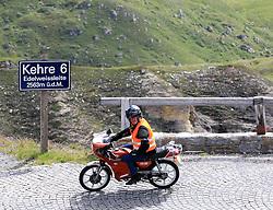 THEMENBILD - Großglockner Hochalpenstraße, Motorradfahrer in der Kehre 6 auf dem Weg zur Edelweißhöhe. Sie verbindet die beiden Bundesländer Salzburg und Kärnten mit einer Länge von 48 Kilometern und ist als Erlebnisstraße von großer touristischer Bedeutung, aufgenommen am 1. August 2015, Heiligenblut, Österreich // A biker at the Großglockner High Alpine Road which connects the two provinces of Salzburg and Carinthia with a length of 48 km and is as an adventure road priority of tourist interest at Heiligenblut, Austria on 2015/08/01. EXPA Pictures © 2015, PhotoCredit: EXPA/ Martin Huber