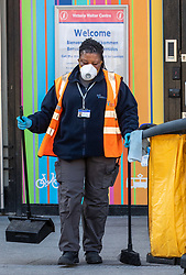 © Licensed to London News Pictures. 16/03/2020. London, UK. A Station worker in a mask at a quiet Victoria Station this morning as Government ministers warn that over 70s will face self-isolation for weeks as the Coronavirus disease pandemic continues . Photo credit: Alex Lentati/LNP