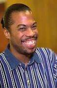 Bearded African American age 35 smiling happily. Exchange Charities Christmas dinner Minneapolis  Minnesota USA