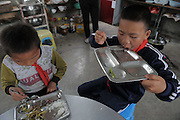 QIANNAN, CHINA - MAY 31: (CHINA OUT) <br /> <br /> Six-pupil School In Mountain Of Qiannan<br /> <br /> Pupils have lunch at Gugang primary school in a mountain in Longli County on May 31, 2016 in Qiannan Buyei and Miao Autonomous Prefecture, Guizhou Province of China. Gugang primary school with only one teacher and six students was located in the mountain where the traffic was blocked in Qiannan. 50-year-old Wu Guoxian had been teaching in this school for 33 years and taught over 1,000 students. More and more people went out of the village to work in the cities leaving their children and the old in the mountain. Five under-school-age kids whose parents left for work also stayed at the school. <br /> ©Exclusivepix Media