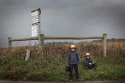 Two Amish boys wait on the side of the road outside Berlin, Ohio, Oct. 13, 2009.