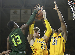 January 7, 2018 - KS, USA - Wichita State center Asbjorn Midtgaard grabs a rebound against South Florida guard Justin Brown during the second half on Sunday, Jan. 7, 2018 at Koch Arena in Wichita, Kan. (Credit Image: © Travis Heying/TNS via ZUMA Wire)