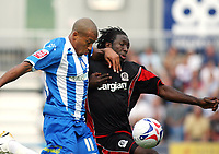 Photo: Chris Ratcliffe.<br />Colchester United v Queens Park Rangers. Coca Cola Championship. 16/09/2006.<br />Damion Stewart of QPR (R) clashes with Chris Iwelumo of Colchester United.