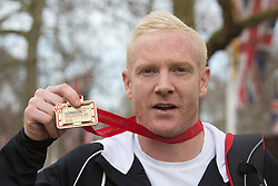 © Licensed to London News Pictures. 21/04/2013. London, England. Picture: Runner Iwan Thomas. Celebrity Runners and Fun Runners finish the Virgin London Marathon 2013 race in the Mall, London. Many wore black ribbons to pay their respect for those who died or were injured in the Boston Marathon. Photo credit: Bettina Strenske/LNP