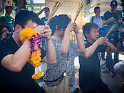 19 AUGUST 2015 - BANGKOK, THAILAND:   People pray during the reopening of the Erawan Shrine. Erawan Shrine in Bangkok reopened Wednesday morning after more than 20 people were killed and more than 100 injured in a bombing at the shrine Monday, August 17, 2015. The shrine is a popular tourist attraction in the center of Bangkok's high end shopping district and is an important religious site for Thais. No one has claimed responsibility for the bombing.     PHOTO BY JACK KURTZ