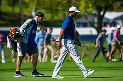 May 16, 2019 - Farmingdale, NY, U.S. - FARMINGDALE, NY - MAY 16: Tiger Woods of the United States walks the fairway with his caddie on the 12th hole during Round One of the PGA Championship Tournament on May 16, 2019, at Bethpage State Park in Farmingdale, NY (Photo by John Jones/Icon Sportswire) (Credit Image: © John Jones/Icon SMI via ZUMA Press)
