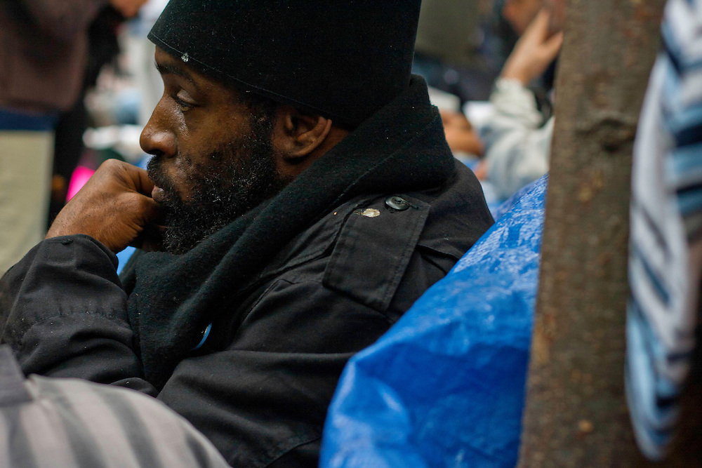 A protester listens to another at a table set up inside Zuccotti Park during the Occupy Wall Street demonstration. October 21, 2011.