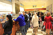 Customers inside baker confectionery shop, La Mallorquina, Calle Mayor, Madrid, Spain