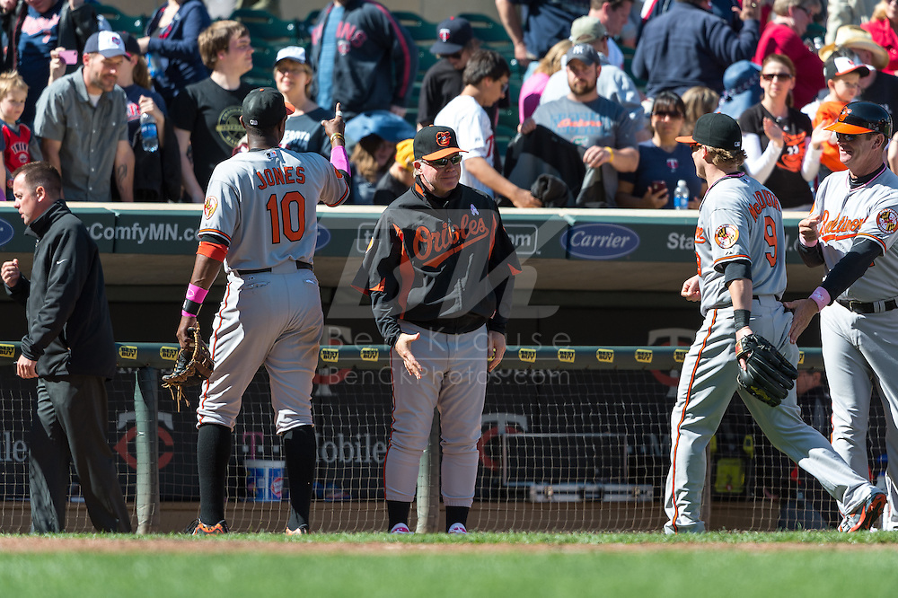 Manager Buck Showalter #26 of the Baltimore Orioles congratulates Nate McLouth #9 after the Orioles defeated the Minnesota Twins on May 12, 2013 at Target Field in Minneapolis, Minnesota.  The Orioles defeated the Twins 6 to 0.  Photo: Ben Krause