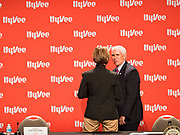 08 MAY 2020 - WEST DES MOINES, IOWA: Iowa Governor KIM REYNOLDS (left) and Vice President MIKE PENCE talk about the security of the food supply chain at Hy-Vee corporate headquarters Friday. He visited Hy-Vee, a regional grocery store chain, to talk about the security of the food supply system. The Governor of Iowa started reopening businesses in the state even though coronavirus (SAR-CoV-2) infections are continuing to rise. President Trump signed an executive order on April 28 to compel meat packing plants to stay open as a part of critical infrastructure, but in Iowa many plants remain closed. The meat packing industry is the main source of COVID-19 infections in rural parts of Iowa. Iowa has recorded 11,457 cases of  COVID-19 and 243 deaths caused by virus.           PHOTO BY JACK KURTZ