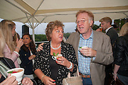 HILARY STIRLING; ANDRW STIRLING, Charlie Gilkes and Duncan Stirling host Inception Group's Hamptons Garden party on the rooftop garden of the Ballymore marketing suite overlooking the site of the new US embassy. Embassy Gardens, London SW8.  12 July 2012.