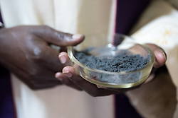 1 March 2017, Thaba Bosiu, Lesotho: Roman Catholic priest holds ashes, at Ash Wednesday in Thaba Bosiu, Lesotho.