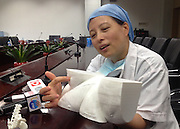 SHANGHAI, CHINA - JUNE 09: (CHINA OUT)<br /> <br /> Siamese Twins Succeed In Separation With Help Of 3D Printed Model<br /> <br /> Deputy head in Children\'s Hospital of Fudan University Zheng Shan introduces the function of 3D printed model according to a pair of siamese girl twins at Children\'s Hospital of Fudan University on June 9, 2015 in Shanghai, China. Children\'s Hospital of Fudan University accepted their 8th operations of separation surgery on a pair of siamese girl twins. The seperation surgery focused on the haunches in lower bodies of siamese twins and gained success with the help of 3D printed model which recovered body fabric of the twins in same proportion for medical workers\' accurate reference. It was said that it\'s first time that Children\'s Hospital of Fudan University applied 3D skills on separation surgery and the siamese girl twins were in good condition in their 80 days after birth.<br /> ©Exclusivepix Media