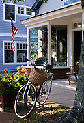 Image of a bicycle in front of an antique store in East Hampton, Long Island, New York, east coast by Randy Wells