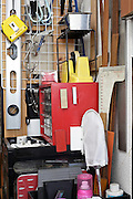 various craft and small construction tools hanging on wall and rack