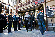 Thousands of Occupy LA protesters march in to the financial district of Los Angeles. The march stopped at several banks including Bank of America on 7th and Figuroa, where several proitesters were aressted..