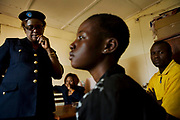 Maj. Honorine Munyole Sikujua, left, looks at a 13-year-old victim of sexual violence who came to the Police for Women and Children (PELVS: Police pour la Protection de l'Enfance, de la femme et de lutte contre les Violences Sexuelle) in April 7, 2009, Bukavu, South Kivu. <br /> The victim came with her uncle to report another uncle who raped and impregnated her. The baby died, and she had a fistula problem. Maj. Honorine called the ambulence from Panzi Hospital to hospitalize her.