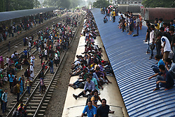 June 23, 2017 - Dhaka, Bangladesh - On 23 June 2017 in Dhaka, bangladeshi passengers travel in an overcrowded trains and launch as they head home ahead of Eid ul-Fitr. A large number of people working in Dhaka leave for their home towns every year to celebrate Eid ul-Fitr with their families. (Credit Image: © Mushfiqul Alam/NurPhoto via ZUMA Press)