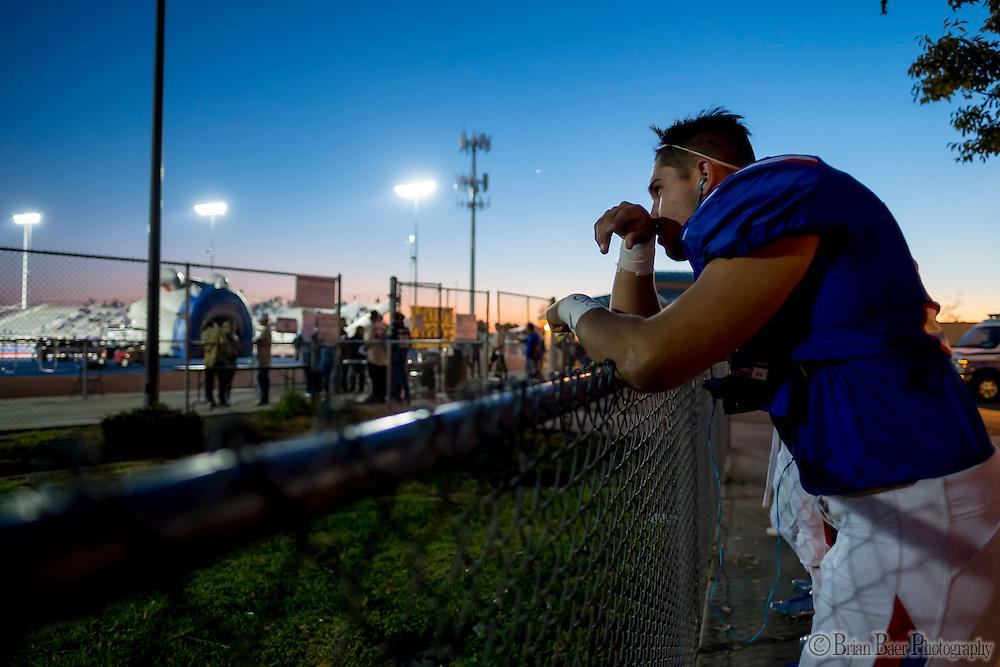 Folsom High School Bulldogs Tyler May (53), watches the JV game before the game as the Folsom High School Bulldogs varsity football team host the Oak Ridge High School Trojans,  Friday Nov 4, 2016.<br /> photo by Brian Baer