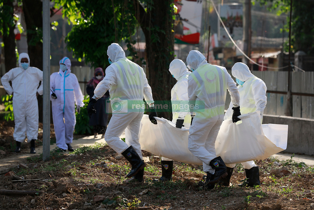 Bangladeshi People wearing protective suits, carry the body of Jalal Saifur Rahman who died due to coronavirus (COVID-19) at a graveyard in Dhaka, Bangladesh, April 6, 2020. Jalal Saifur Rahman, a director of Bangladesh government's main anti-graft body died due to coronavirus on Monday morning in the capital Dhaka. Jalal Saifur Rahman, was admitted to a hospital after having tested positive for coronavirus one week ago. Photo by Suvra Kanti Das/ABACAPRESS.COM