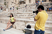 A Chinese tourist photographs his girlfriend. Tourists and visitors climbing up the marble stept towards the Acropolis of Athens. The main buildings on the Acropolis were built by Pericles in the fifth century BC as a monument to the cultural and political achievements of the inhabitants of Athens. The term acropolis means upper city and many of the city states of ancient Greece are built around an acropolis where the inhabitants can go as a place of refuge in times of invasion. It's for this reason that the most sacred buildings are usually on the acropolis. It's the safest most secure place in town. As little as 150 years ago there were still dwellings on the Acropolis of Athens. Athens is the capital and largest city of Greece. It dominates the Attica periphery and is one of the world's oldest cities, as its recorded history spans around 3,400 years. Classical Athens was a powerful city-state. A centre for the arts, learning and philosophy.
