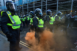 © Licensed to London News Pictures. 15/05/2021. London, UK. Free Palestine protesters throw drinks, eggs and flares at the police in Kensington, central London near the Israeli Embassy. Photo credit: Marcin Nowak/LNP