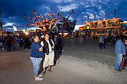10 SEPTEMBER 2004 - WINDOW ROCK, AZ: The carnival midway at the 58th annual Navajo Nation Fair in Window Rock, AZ. The Navajo Nation Fair is the largest annual event in Window Rock, the capitol of the Navajo Nation, the largest Indian reservation in the US. The Navajo Nation Fair is one of the largest Native American events in the United States and features traditional Navajo events, like fry bread making contests, pow-wows and an all Indian rodeo. PHOTO BY JACK KURTZ