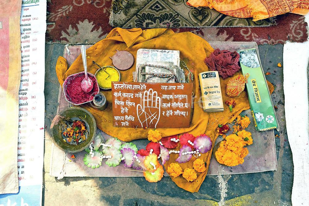 Rice paste, offerings and palm reading accessories at Pashupatinath Hindu temple, Kathmandu, Nepal