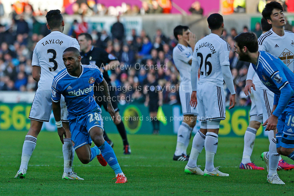 Jermain Defoe of Sunderland turns away to celebrate after scoring his side's first goal.<br /> Barclays Premier League match, Swansea City v Sunderland at the Liberty stadium in Swansea, South Wales on Saturday 7th Feb 2015.<br /> pic by Mark Hawkins, Andrew Orchard sports photography.