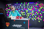 Bruce Breslau of AARP talks with an attendee at the commitment wall at the AARP Block Party at the Albuquerque International Balloon Fiesta in Albuquerque New Mexico USA on Oct. 7th, 2018.