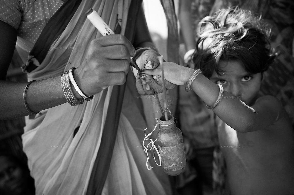 Finger marking during a house-to-house immunization at a Muslim village. Raniganj block, Araria district, Bihar