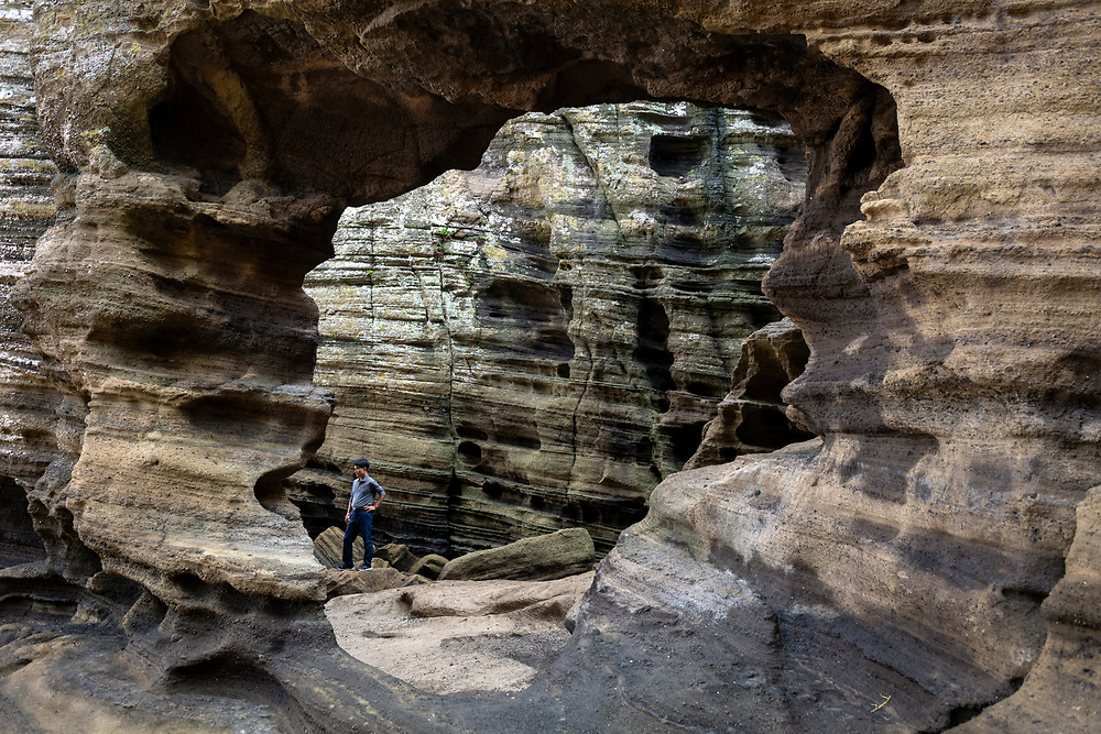 Jeju Island, South Korea - September 15, 2019: A man explores the Yongmeori Coast, a UNESCO World Heritage Site on Jeju Island, South Korea.