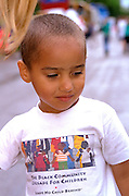 Thoughtful boy age 4 at the Parktacular Parade.  St Louis ParK  Minnesota USA