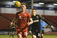 AFC Wimbledon defender Steve Seddon (15) closes the ball down during the EFL Sky Bet League 1 match between Walsall and AFC Wimbledon at the Banks's Stadium, Walsall, England on 12 February 2019.