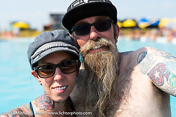 Jon and Pinky Barwood in the Swimming pool at the Full Throttle Saloon during the 78th annual Sturgis Motorcycle Rally. Sturgis, SD. USA. Thursday August 9, 2018. Photography ©2018 Michael Lichter.