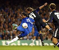 Photo: Chris Ratcliffe.<br />Chelsea v Anderlecht. UEFA Champions League.<br />13/09/2005.<br />Didier Drogba gets ahead of Mark De Man of Anderlecht but cannot connect.