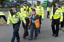 © Licensed to London News Pictures 15/09/2021. <br /> Dartford, UK, A protester arrested by police. Insulate Britain protesters have glued themselves to the road on Bluestar roundabout at Junction 1b of the M25 in Dartford, Kent. Photo credit:Grant Falvey/LNP