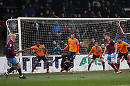 Oldham Athletic goalkeeper Johnny Placide (19) makes a save from Scunthorpe United forward Luke Williams (7)  during the EFL Sky Bet League 1 match between Scunthorpe United and Oldham Athletic at Glanford Park, Scunthorpe, England on 3 March 2018. Picture by Mick Atkins.