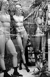 Undressed mannequins in a store window