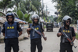 September 5, 2017 - Dhaka, Bangladesh - Law enforcers surrounds a suspected militant hideout at Mirpur in the capital Dhaka, Bangladesh, on 7 September 2107..  Abdullah the suspected militant hiding at the 4th floor of a building along with his wives, two children and two other suspected militants. Later they exploded a suicidal bomb and killed themselves. (Photo by Khandaker Azizur Rahman (Credit Image: © Khandaker Azizur Rahman Sumon/NurPhoto via ZUMA Press)
