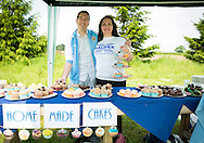 20140601 Free for editorial use image<br /> <br /> Halifax colleagues in Bournemouth are proud to give extra back to their local community by hosting their Big Lunch event on Sunday 01 June 2014.<br /> <br /> Halifax staff Claire Wootten and partner Richard Wild man the cake stand during The Big Lunch at the New Leaf Allotment in Bournemouth. <br /> <br /> For more information please contact: Catherine Eastham on 020 3697 4304<br /> <br /> If you require a higher resolution image or you have any other onEdition photographic enquiries, please contact onEdition on 0845 900 2 900 or email info@onEdition.com<br /> This image is copyright the onEdition 2014©.<br /> This image has been supplied by onEdition and must be credited onEdition. The author is asserting his full Moral rights in relation to the publication of this image. Rights for onward transmission of any image or file is not granted or implied. Changing or deleting Copyright information is illegal as specified in the Copyright, Design and Patents Act 1988. If you are in any way unsure of your right to publish this image please contact onEdition on 0845 900 2 900 or email info@onEdition.com