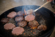 Kelvin Lester, a meat grinder at the Rochester Meat Company in Rochester, Minnesota, grills hamburger patties brought from work at his home in Grand Meadows, Minnesota.  (Kelvin Lester is featured in the book What I Eat: Around the World in 80 Diets.)